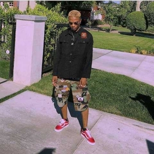 Wizkid's New Super Hair Cut Got Fans Blushing Like Seriously! Made Him Look Just Like Justin Bieber (Yar Or Nay)?